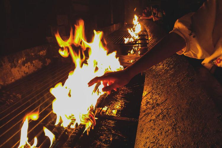 I touch and I was burned The Week on EyeEm Eyeem Philippines Shrine Zamboanga Zamboanga City Fort Pilar Candles Mobilephotography Human Hand Flame Men Heat - Temperature Burning Campfire Fire - Natural Phenomenon