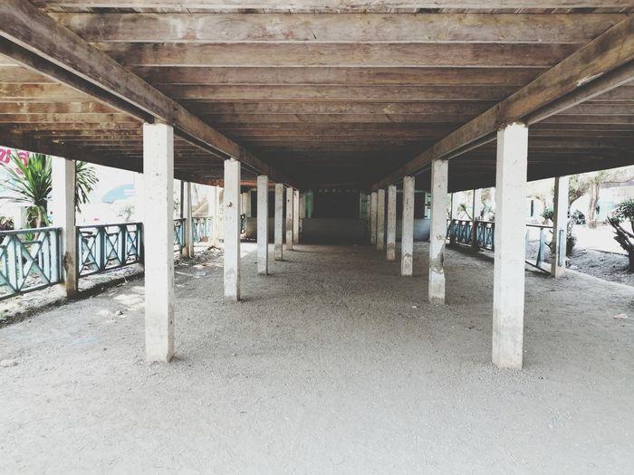 Wood Home Architectural Column Bridge - Man Made Structure Graffiti Architecture Built Structure Underneath Under Pillar Passage Ceiling Light  Ceiling Street Art Passageway vanishing point Below