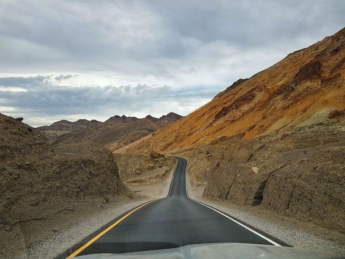 Artist Drive. Death Valley California Mood EyeEm Selects Summer Road Tripping Mountain Desert Road Winding Road Road Trip Arid Climate Adventure Sky Landscape Cloud - Sky Mountain Road Rocky Mountains Empty Road Geology Arid Landscape Canyon Rock Formation Sand Dune