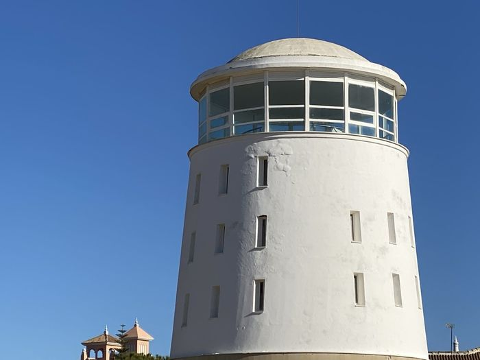 Low angle view of lighthouse against clear sky