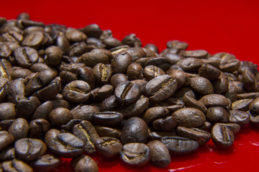 The Roasted Coffee Beans red background macro close up image for coffee background. Roasted Coffee Beans Coffee Beans Baker Coffee Beans Roasted Close-up Coffee Beans Coffee Beans For Sale Coffee Beans Roaster Food Food And Drink Freshness Indoors  No People Red Roasted Roasted Coffee Roasted Coffee Bean