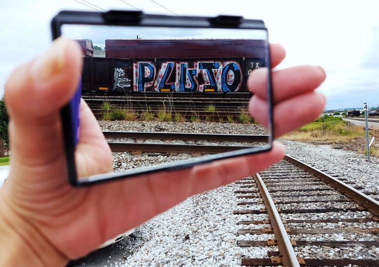 Urban Art Graphite Art Graffiti Photography Themes Human Hand Human Body Part Day People Outdoors Adult Close-up Mirror Image Mirror Reflection Mirror Train Tracks EyeEmNewHere The Street Photographer - 2017 EyeEm Awards