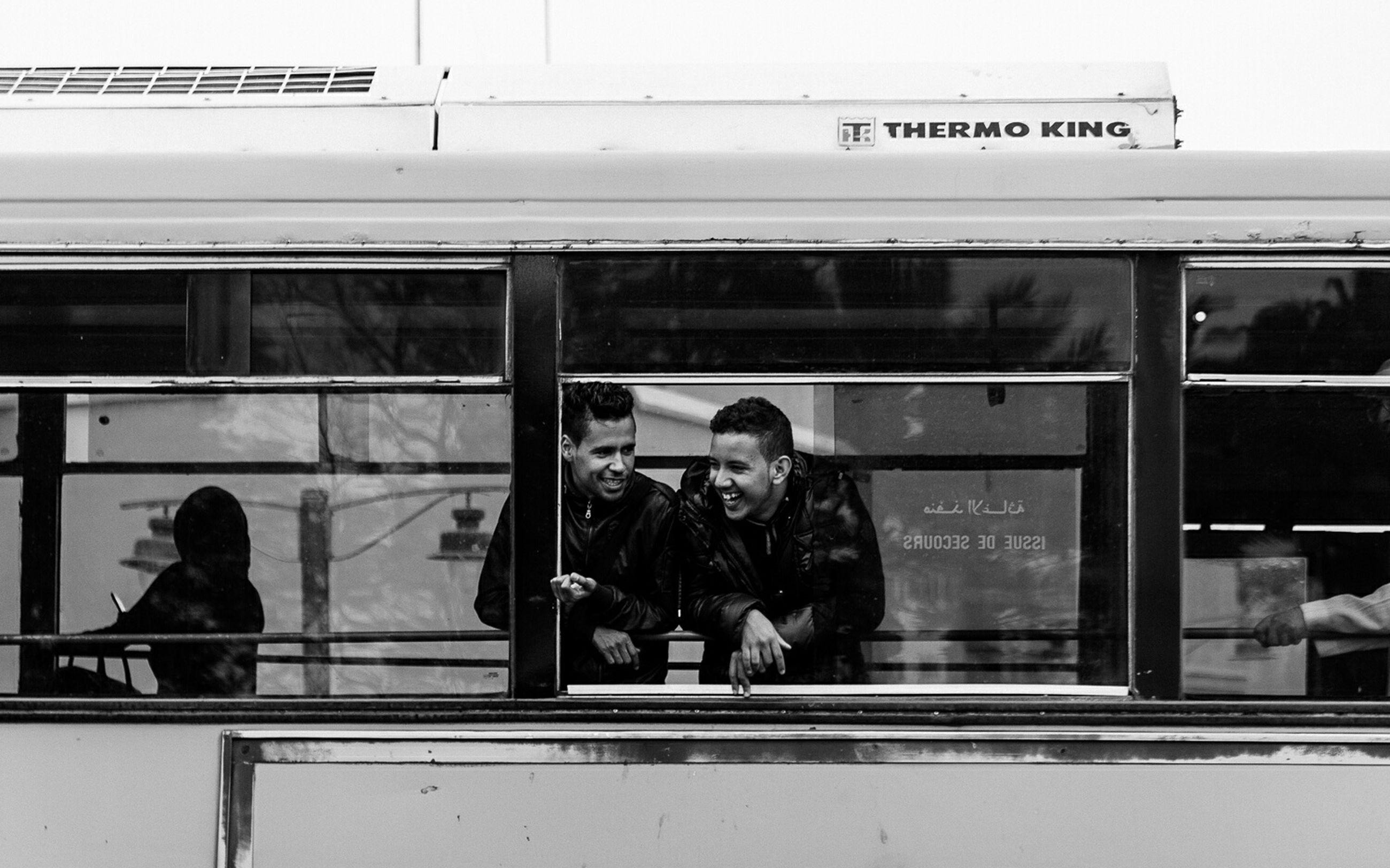 transportation, men, public transportation, text, communication, lifestyles, western script, mode of transport, railroad station, indoors, person, train - vehicle, travel, rail transportation, non-western script, railroad station platform, leisure activity, passenger