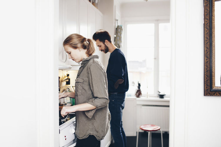 Couple standing at home