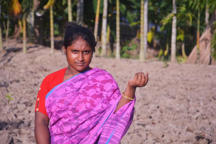 Portrait of girl standing on land