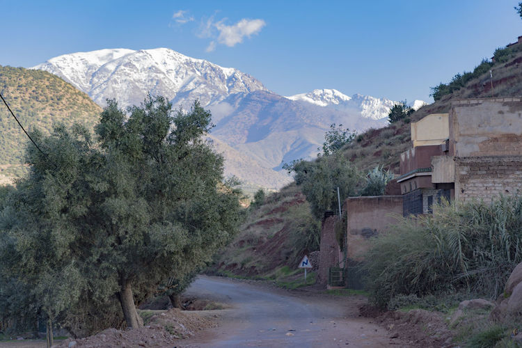Mountain Mountain Range Sky Day Road Mountain Road Snowcapped Mountain Snowcapped Mountains Ridgeline Valley Light Light And Shadow Morocco Atlas Mountain Atlas Mountains North Africa Landscape Building Village Villages Mountain Village Plant Architecture Tree No People