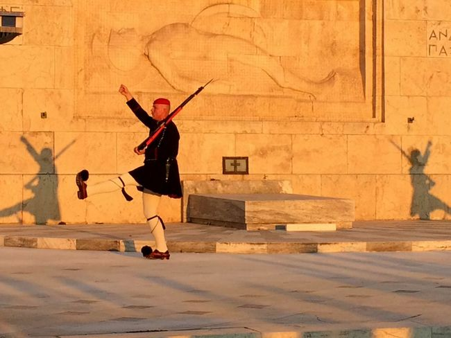Adult Architecture Arms Raised Athens, Greece Built Structure Day Full Length Greece Guards Men One Man Only One Person Outdoors Parade People Presidential Guard Real People Standing Sunset Silhouettes The Street Photographer - 2017 EyeEm Awards Tradition