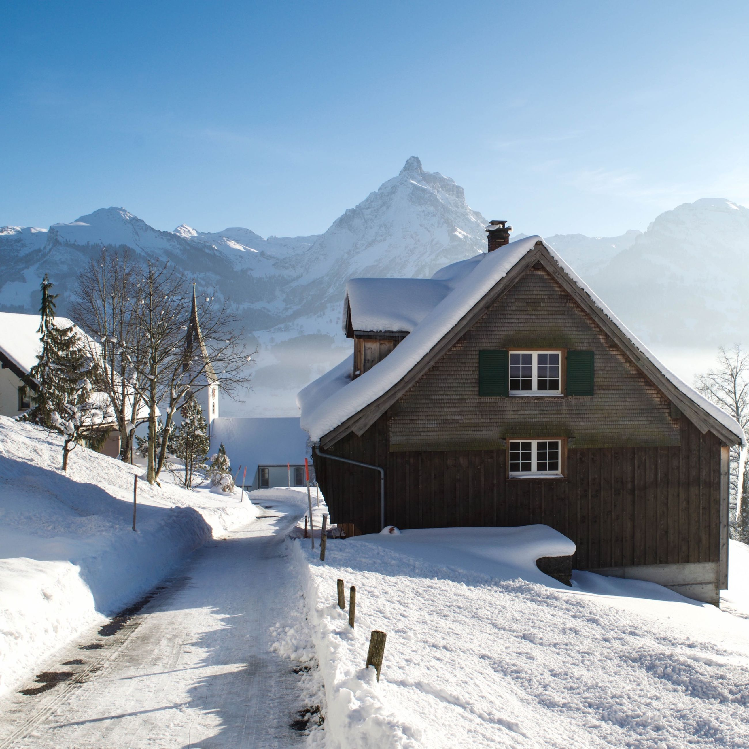snow, winter, cold temperature, mountain, season, building exterior, house, built structure, architecture, weather, covering, snowcapped mountain, mountain range, white color, residential structure, landscape, tranquil scene, nature, clear sky, tranquility