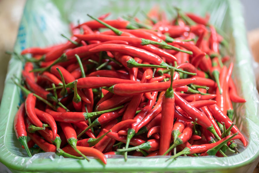 piment Red Food And Drink Vegetable Food Spice Chili Pepper Pepper Large Group Of Objects Red Chili Pepper Freshness Close-up Still Life Container No People Wellbeing Abundance Green Color Healthy Eating High Angle View Indoors