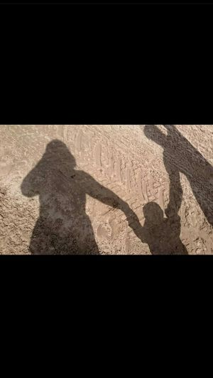 Shadow Sunlight Focus On Shadow Outdoors Family Holiday Uk Holiday Mummy Daddy Real People Day Close-up Baby Sand Beach Western Super Mare Holding Hands No Filter, No Edit, Just Photography Tracks