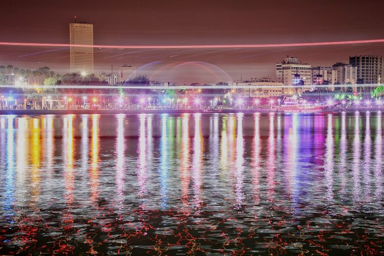 Colors and city Water Architecture Built Structure Nature Reflection Building Exterior Multi Colored Night Illuminated Motion City Sky Travel Destinations Beauty In Nature Scenics - Nature No People Waterfront Pink Color Tourism