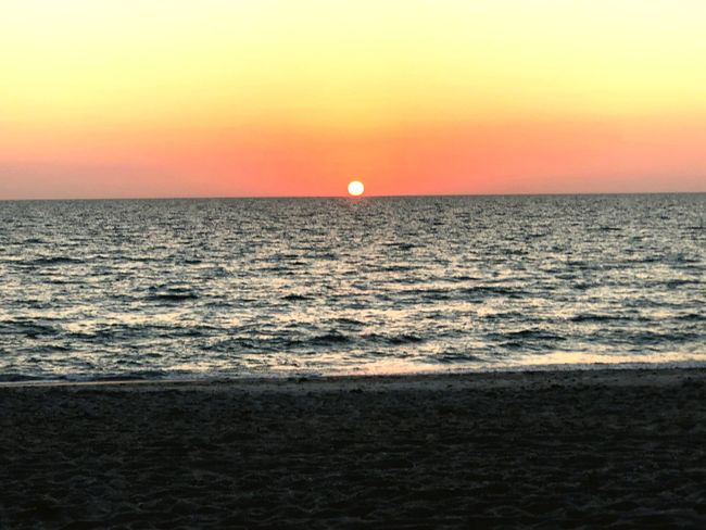 The moment we wait for each day. Cya Sunset Sea Horizon Over Water Scenics Beauty In Nature Tranquil Scene Nature Tranquility No People Travel Destinations Beach Outdoors Clear Sky Idyllic Sun Horizon Orange Color Moon Water Sky
