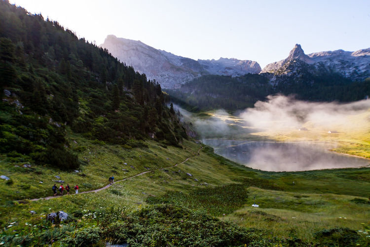 Scenic view of berchtesgaden alps against clear sky in foggy weather