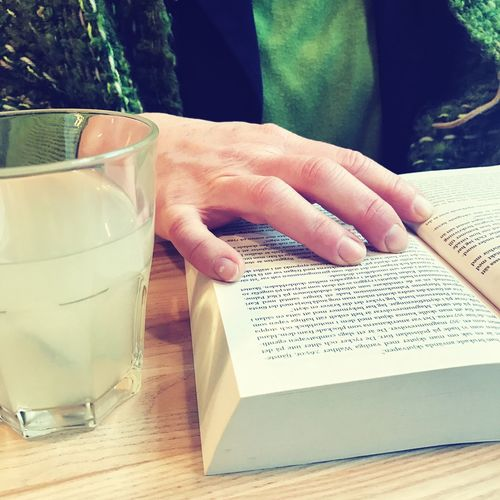 Reading a book Lemonade Sirop Paperback Pocketbook EyeEm Selects Real People Human Hand Table Drinking Glass Book Drink Refreshment One Person Indoors  Human Body Part Food And Drink Day Close-up Women Freshness