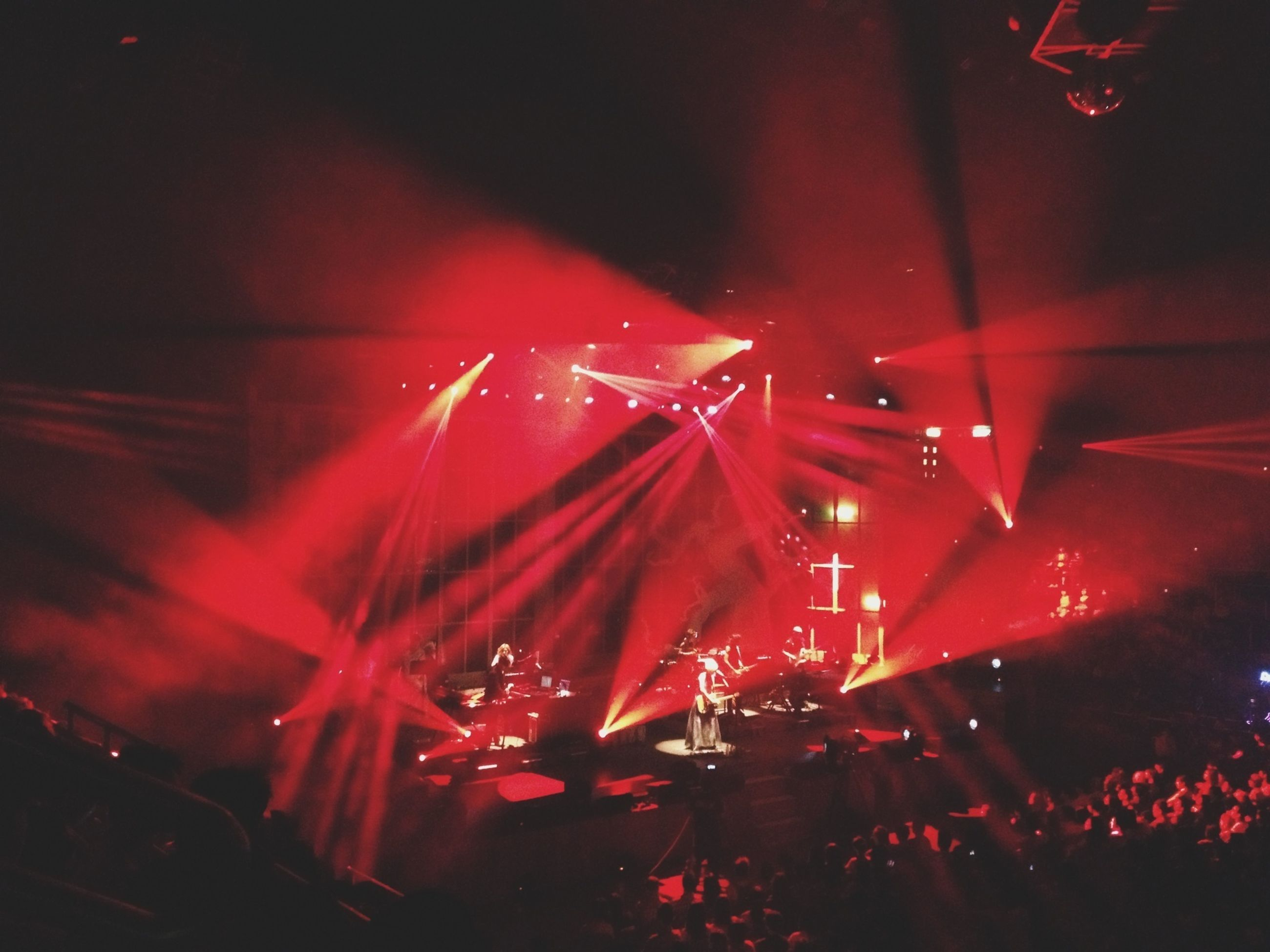 illuminated, night, indoors, nightlife, men, large group of people, arts culture and entertainment, lighting equipment, lifestyles, light - natural phenomenon, leisure activity, performance, music, stage - performance space, crowd, person, nightclub, event