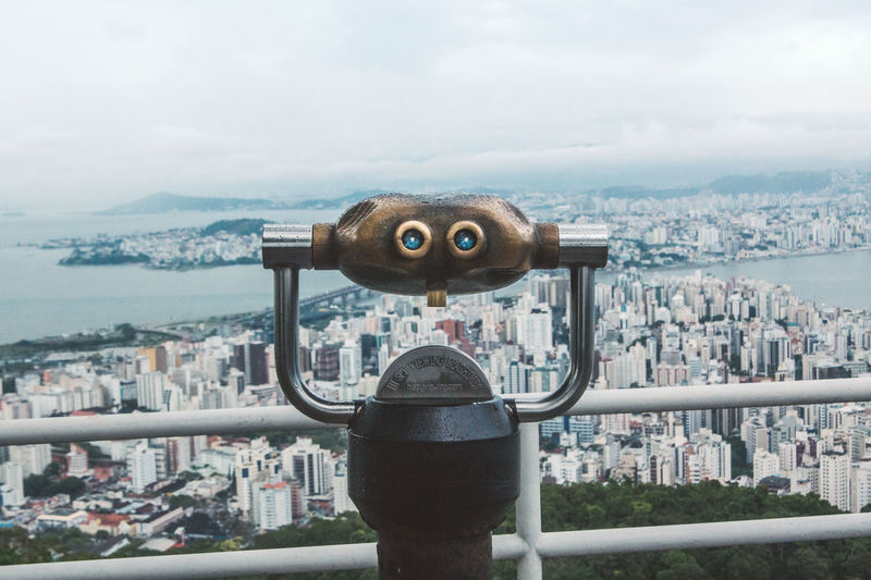 View over Florianópolis. Railing Travel Travel Photography Traveling Architecture Binoculars Building Exterior Built Structure City Cityscape Close-up Coin Operated Coin-operated Binoculars Crowded Day Hand-held Telescope Island Metal Outdoors Sky Telescope Travel Destinations Viewpoint Wall-e Water Adventures In The City