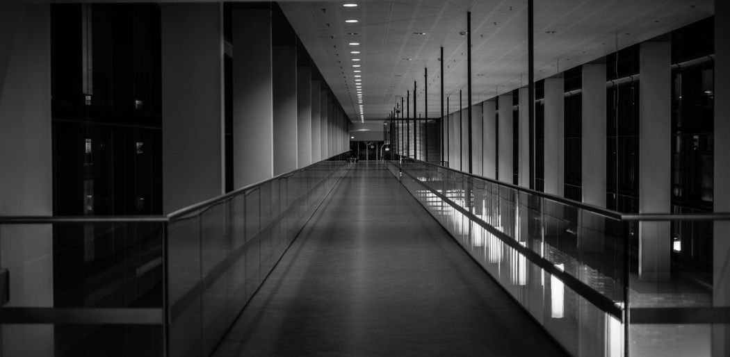 Down the hallway... Textured  Dept Copyspace Copy Space Architecture Built Structure Direction The Way Forward Building Illuminated Arcade Reflection Lighting Equipment Indoors  Real People Incidental People Walking Lifestyles Diminishing Perspective In A Row Corridor Flooring Ceiling