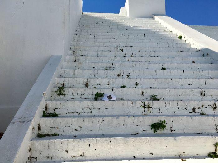 Close-up of steps against sky