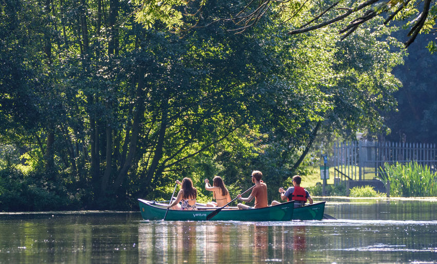 Summer canoeing on the river. Boating Canoe Canoeing Having Fun On The River Summer Sun Summer Fun Summer On The River Summertime Bikini Boat Bonding Canoes Group Of People Leisure Activity Lifestyles Messing On The River Real People River Summer Togetherness Water