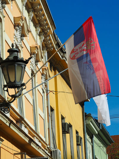 European Cities Novi Sad Serbia Balkans Europe Eastern Europe Outdoors Clear Blue Sky Architecture Facades Building Exterior Built Structure Low Angle View City Building Heritage Building Historical Place Painted Buildings The Past Sky Flag Patriotism No People Day Sunlight National Icon Pride