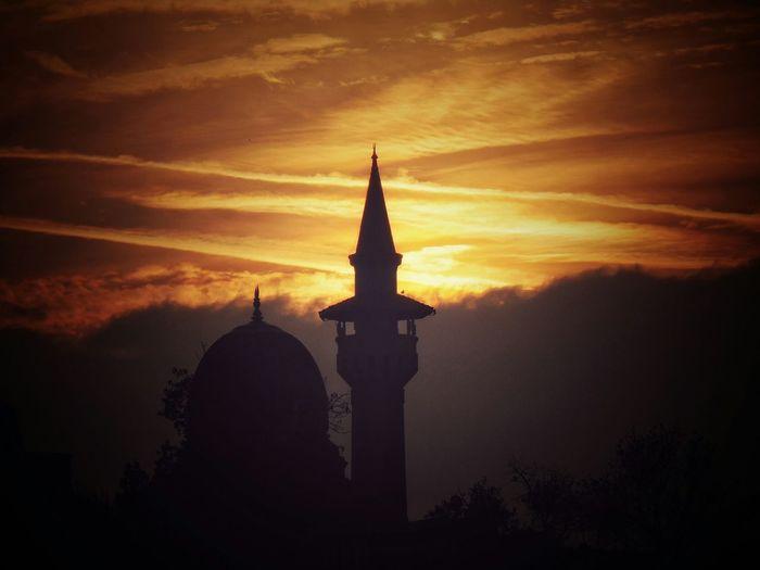 Silhouette of church against sky