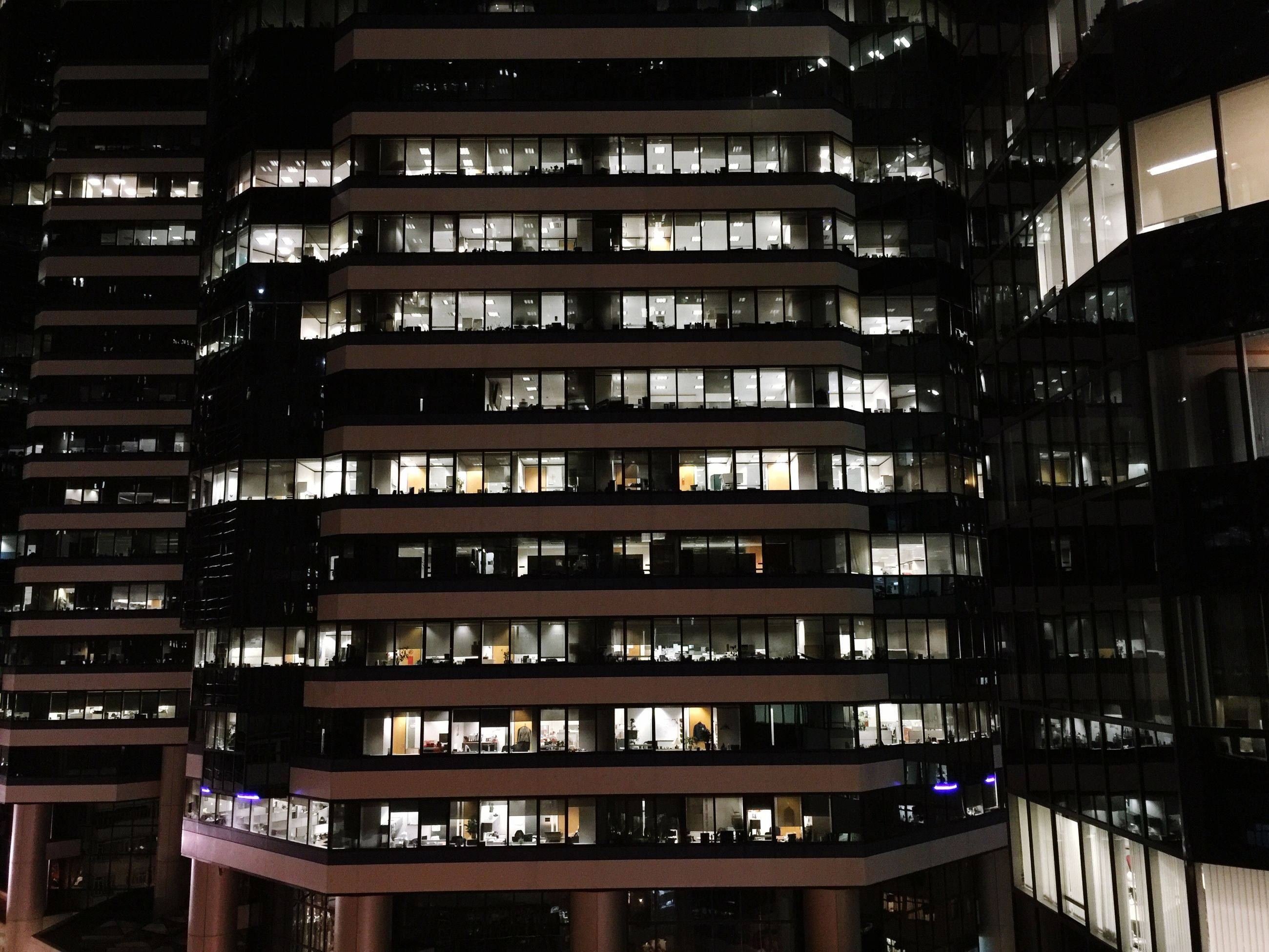 architecture, built structure, building exterior, illuminated, night, low angle view, modern, city, building, window, balcony, apartment, residential building, no people, indoors, repetition, residential structure, in a row, office building, glass - material