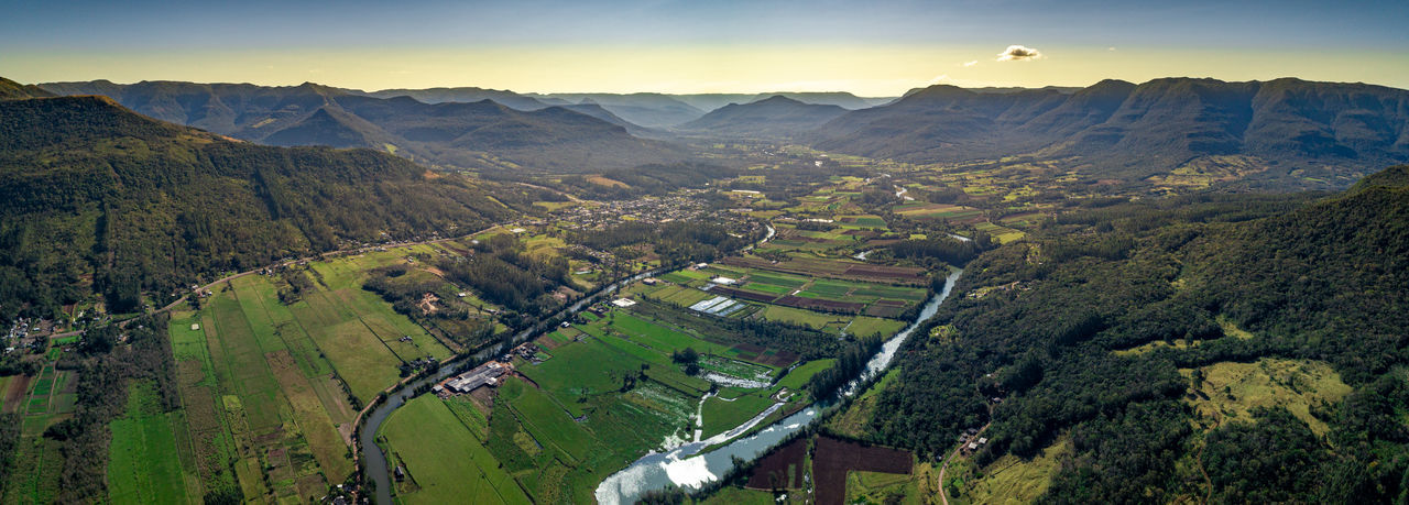 High angle view of farms against sky