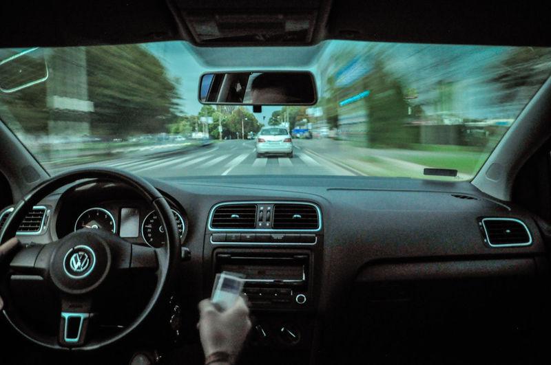 Blurry Car Car Interior City Dashboard Day Driving Fast Indoors  Motion Quickness Rapidity Road Rush Speed Speeding Speedometer Steering Wheel Transportation Vehicle Interior Velocity
