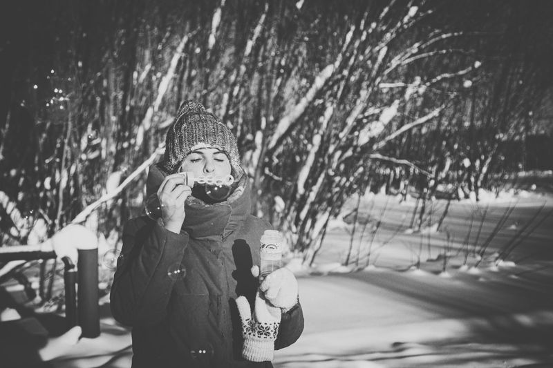 Portrait of boys standing in snow
