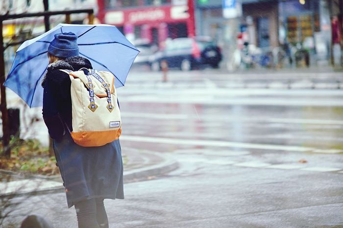 Umbrella EyeEm Selects Umbrella Protection Wet Rain Security Focus On Foreground City Street Day Water Real People One Person Rainy Season Rear View Walking Architecture Nature Road Outdoors
