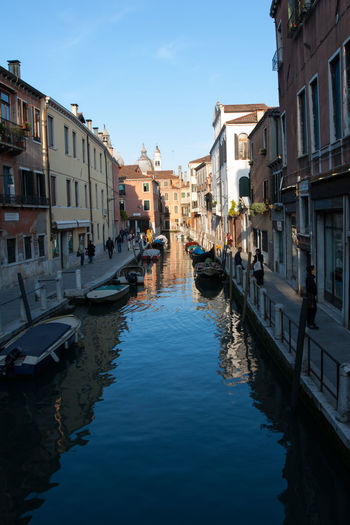 A small canal in the Cannaregio district of Venice, away from the main tourist areas. Building Exterior Nautical Vessel Architecture Built Structure Water Transportation Canal Mode Of Transportation Building City Waterfront Residential District Nature Reflection Moored Sky Day Incidental People Gondola - Traditional Boat Outdoors Diminishing Perspective Venice, Italy Blue Sky