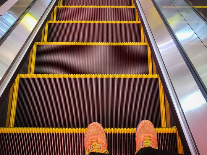 Slide Down Escalator Escalators And Staircases Elevator Elevated Road Elevated Walkway Department Store Low Section Modern Pattern Architecture Close-up Footwear Pair Flip-flop Human Leg Human Foot Shoe Spiral Staircase Steps And Staircases Shoelace Personal Perspective Flat Shoe