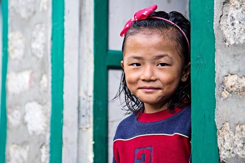 Nepal Nepal Travel Everest Base Camp Trek Childhood Portrait Portrait Photography Child One Person Children Only Outdoors Smiling People Close-up Nepalese Nepali Culture House Doorway Shygirl Bow Hairband Eyem Best Shots Eyem Gallery Eyem Collection EyeEm Portraits