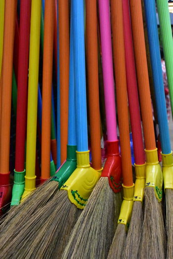 Close-up of multi colored mops for sale