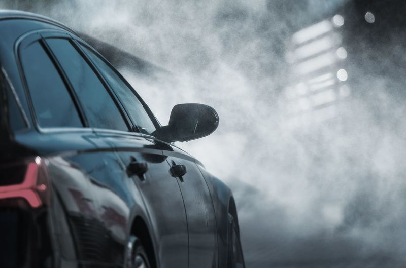 Car On Road Against Smoke