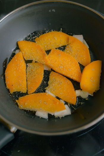 High angle view of orange slices in bowl