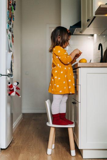 Full length of girl standing at home