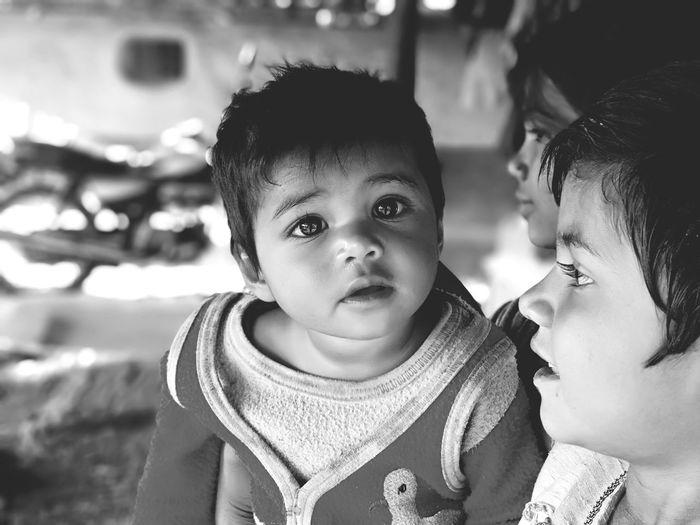 EyeEm Selects Blackandwhite Rural Scene Village Warm Clothing Child Portrait Childhood Men Togetherness Bonding Males  Females Winter Baby Carriage