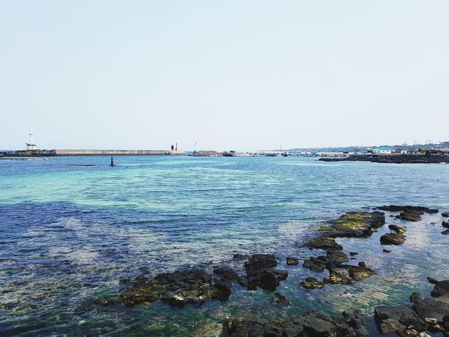 Blue sea Sea Beach Horizon Over Water Outdoors Day Nature Tranquil Scene Beauty In Nature Tranquility Sky Scenics Vacations Low Tide Landscape Nautical Vessel Water Eyeemphotography Korea Travel Destinations Harbor Blue Port