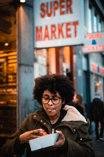 Raphaela eating - as usual! City Holding One Person Curly Hair Young Adult Incidental People Communication City Life Lifestyles Coffee - Drink Glasses Take Out Food Hairstyle Food Tealandorange Eye4photography  City Life EyeEm Best Shots EyeEm Selects