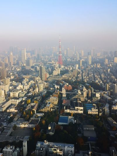 Aerial view of cityscape against clear sky