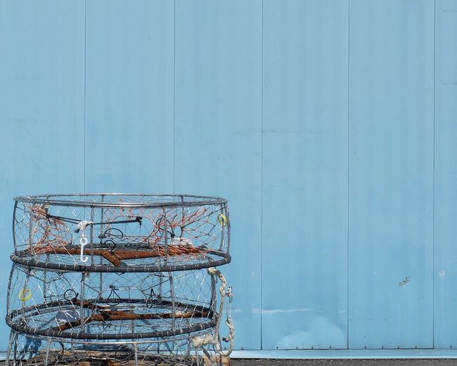 Netted Containers Next To Blue Wall