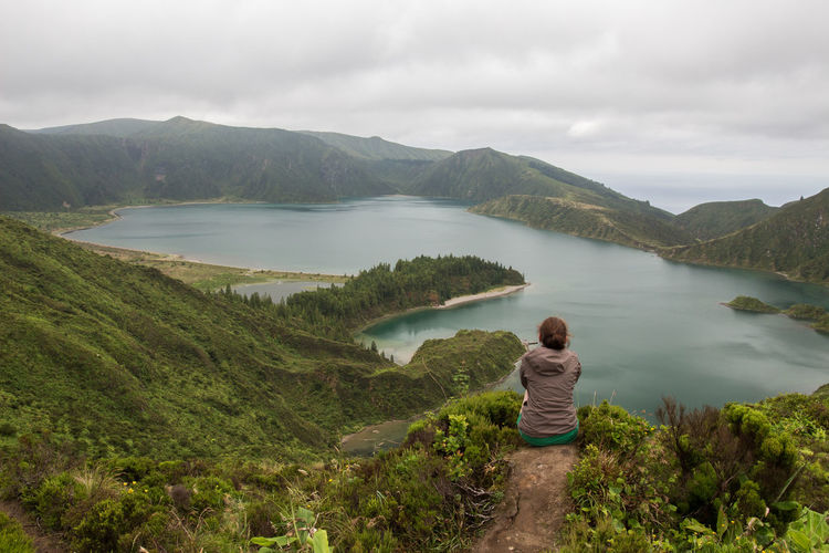 Lonely Girl with amazing view of a Lake Adult Azores Beauty In Nature Cloud - Sky Day Fog Lagoa Do Fogo Lake Lake View Landscape Mountain Mountain Range Nature One Person One Woman Only My Year My View Outdoors People Rear View Scenics Travel Destinations Vacations Water Women Young Adult Miles Away Live For The Story