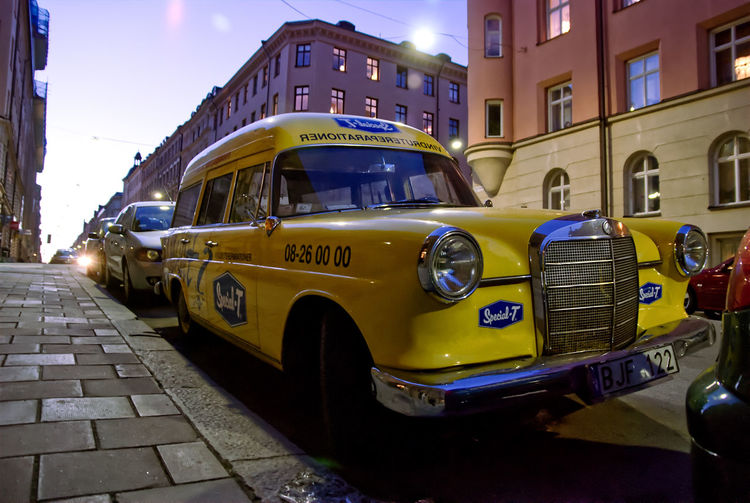 View of yellow car on city street