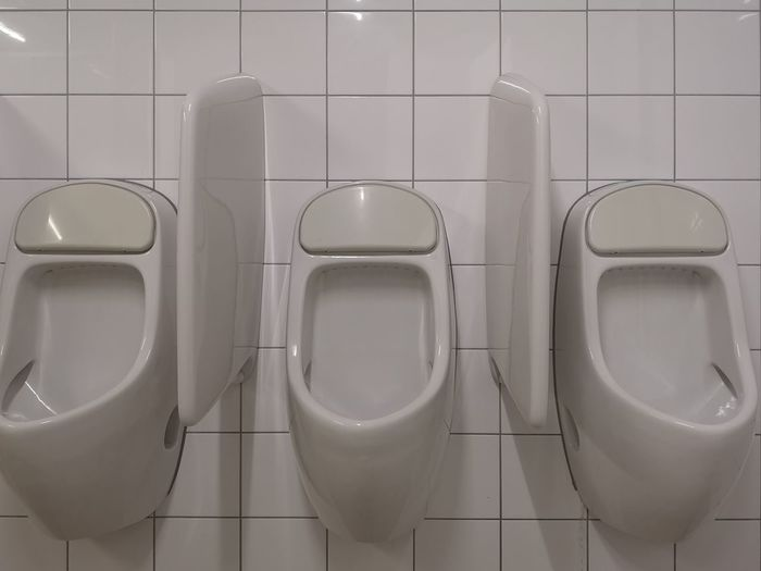 Three urinal in