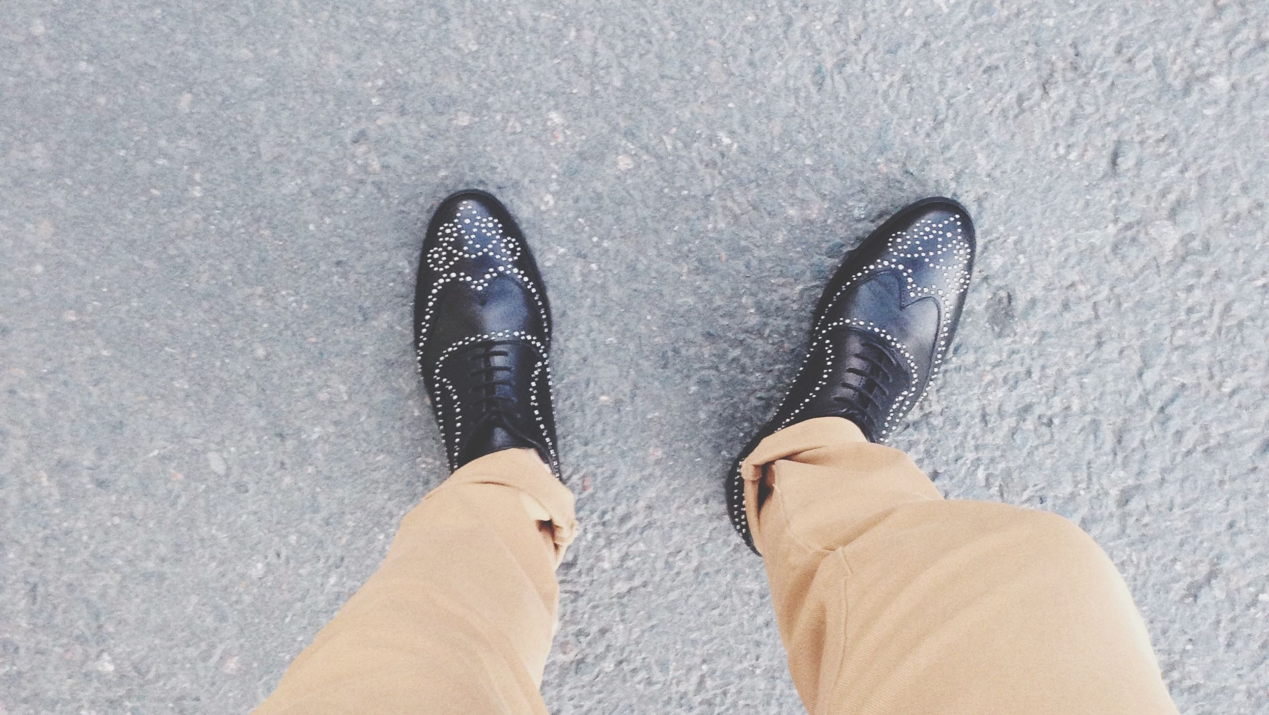 low section, person, personal perspective, shoe, human foot, footwear, high angle view, standing, lifestyles, directly above, unrecognizable person, leisure activity, part of, men, jeans, street, human limb