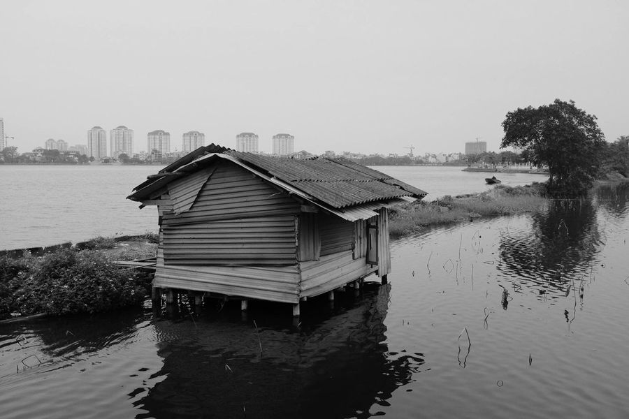Lake shack in Hanoi, Vietnam. Water Built Structure Lake Nature Waterfront Outdoors Architecture Tree Day No People Tranquility Building Exterior Tranquil Scene Scenics Sky Nautical Vessel Beauty In Nature Boathouse First Eyeem Photo