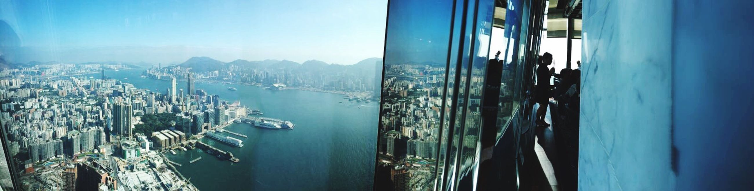 sea, panoramic, blue, reflection, transportation, mountain, architecture, sky, water, skyscraper, nautical vessel, building exterior, built structure, harbor, city, cityscape, scenics, outdoors, nature, business finance and industry, no people, day