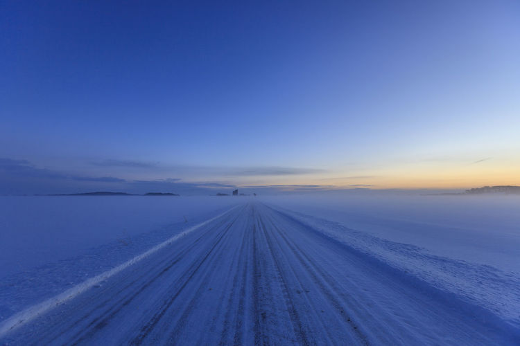 Sunset_collection Sweden Beauty In Nature Blue Cloud - Sky Cold Temperature Diminishing Perspective Direction Environment Nature No People Scania Scenics - Nature Sky Snow Sunset The Way Forward Tranquil Scene Tranquility Transportation vanishing point Winter