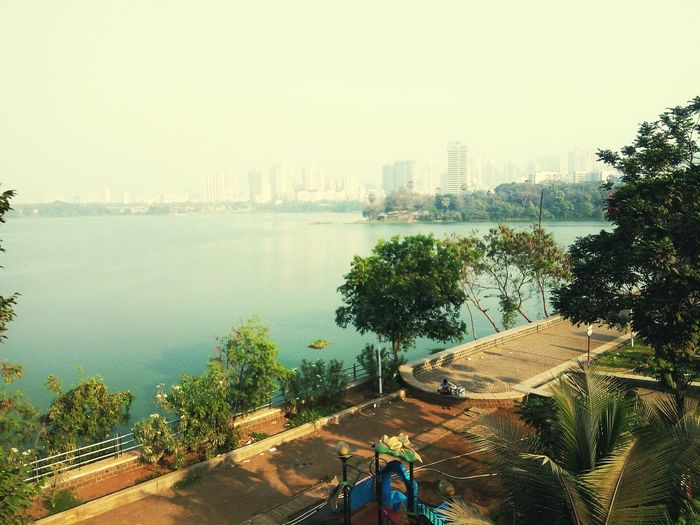 City Skyscraper Cityscape Urban Skyline Architecture Tree Downtown District Nature Outdoors City Life Mumbai MumbaiDiaries Mobile Photography Mumbaiphotography Powai Lake View Powai Lake Powai Garden Mumbai Lakeview Tree_collection  Tree And Sky Shadows And Sunlight Peaceful View The Great Outdoors - 2017 EyeEm Awards The Photojournalist - 2017 EyeEm Awards Live For The Story The Street Photographer - 2017 EyeEm Awards The Great Outdoors - 2018 EyeEm Awards
